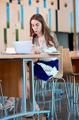 Girl Studying In The University Canteen