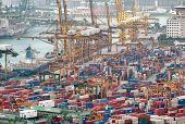 SINGAPORE - 2 JAN, 2014: Commercial port of Singapore. Cargo ships loading and unloading containers