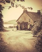 Vintage Style Photo Of Rural Cottage By The Sea