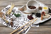 pic of hieroglyphic symbol  - Traditional chinese herbal medicine ingredients with not real hieroglyphs - JPG