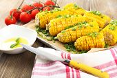 stock photo of corn cob close-up  - Grilled corn cobs on table - JPG