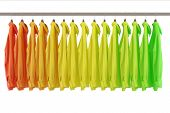 Assorted colored shirts hanging on a clothing rail (3D Rendering)