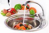 picture of mixing faucet  - Washing fruits and vegetables close - JPG