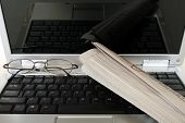 Laptop with Eyeglasses and Newspaper