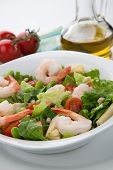 foto of shrimp  - Plate of Italian shrimp salad with shrimp tomatoes artishocke hearts Romane lettuce leaves fava beans and pine nuts - JPG