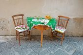 table setting for two in Ortigia Old Town of Siracusa, Sicily