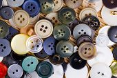 picture of orifice  - the background of a large number of buttons closeup - JPG