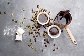Turkish Coffee with coffee beans and Cardamom scattered on a vintage background
