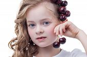 Portrait of lovely freckled girl with cherries