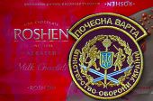 Illustrative editorial. Chevron of Ukrainian Honored Guard of President..With logo Roshen Inc. Trademark Roshen is property of ukrainian president Poroshenko.At December 20,2014 in Kiev, Ukraine