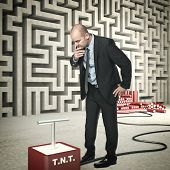 businessman tnt and abstract wall maze