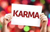 Karma card with colorful background with defocused lights