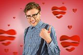 Geeky hipster showing thumbs up against red vignette