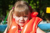 girl in a life jacket smiling
