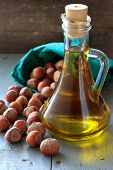 Hazelnut Oil In The Glass Bottle And Nuts
