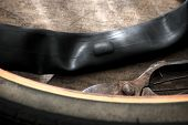 Repairing a flat tire of an bicycle tire. Patched up inner tube of an bicycle tire.
