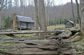 stock photo of gatlinburg  - Vintage log cabins and split rail fence near Gatlinburg - JPG