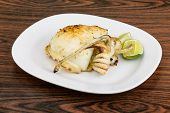 stock photo of cuttlefish  - Grilled cuttlefish with lime on the wooden background - JPG