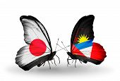 Two Butterflies With Flags On Wings As Symbol Of Relations Japan And  Antigua And Barbuda