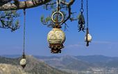 Four Stone Idol Hanging On A Pine Tree In The Crimean Mountains