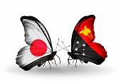 image of papua new guinea  - Two butterflies with flags on wings as symbol of relations Japan and Papua New Guinea - JPG