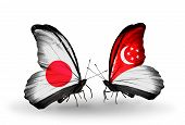 Two Butterflies With Flags On Wings As Symbol Of Relations Japan And Singapore