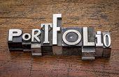 stock photo of typing  - portfolio  word in mixed vintage metal type printing blocks over grunge wood - JPG