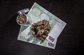Metal Grinder With Marijuana And Money