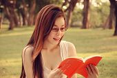 Girl Is Reading Book