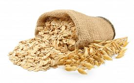 stock photo of oats  - oatmeal in a bag and oats isolated on white - JPG