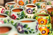 Variety of Colorfully Painted Ceramic Pots.