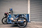 stock photo of towing  - the tow motorcycle in Chiangmai Thailand has used to carry many thing in the market - JPG