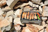 foto of brazier  - fresh red fish fried on a brazier with hot coals - JPG