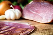 picture of smoked ham  - sliced and smoked ham with schwarzwald ham or prosciutto - JPG