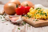 picture of scrambled eggs  - Horizontal photo of Scrambled eggs with chive tomatoes onion garlic and salt - JPG