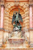 pic of michel  - The statue of Saint Michael atop the fountain in the Place Saint - JPG