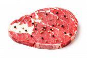 picture of rib eye steak  - Close up raw beef rib eye steak with pepper isolated on white  - JPG