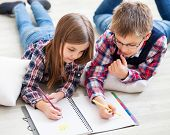 picture of pry  - Brother and sister drawing with crayons in living room - JPG