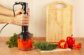 pic of blender  - Hands of cook mixed red pepper and tomato in a blender - JPG