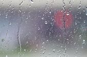 picture of raindrops  - Dirty window glass with water vapor and raindrop during a rainstorm - JPG