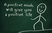 stock photo of positive thought  - On the blackboard draw character and write A positive minds will give you a positive life - JPG
