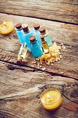 picture of gels  - Bottles with blue shower gel on wooden background - JPG