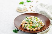 stock photo of chickpea  - salad with chickpeas feta and parsley on a white background