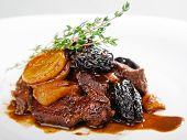 foto of veal  - Veal with dried fruits over white background - JPG