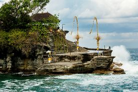 image of tanah  - famous Tanah Lot Temple on Sea in Bali Island Indonesia with blue sky and waves - JPG