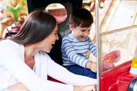 pic of merry-go-round  - happy woman with little boy having fun on merry - JPG