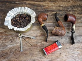 picture of tobacco-pipe  - Three wooden curved pipes - JPG