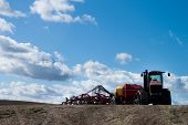 image of last day work  - large field in Idaho farm equipment waiting for the last run of the season - JPG