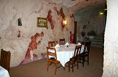 stock photo of bottomless  - tables of an underground restaurant at coober pedy - JPG