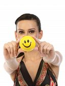 Teenage girl with yellow smile ball